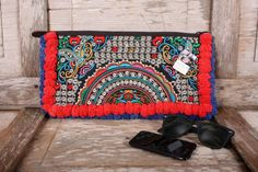 """Bohemian style colorful clutch wallet with two tone pom pom's to trim handmade in Thailand.  Length - 16"""" Height - 8""""  Reference:  BG458-CLBC2P140D15  - See more at: http://www.offbeatboutique.com/en/clutch/622-colorful-two-tone-clutch-purse.html#sthash.a6vW1Xn6.dpuf"""
