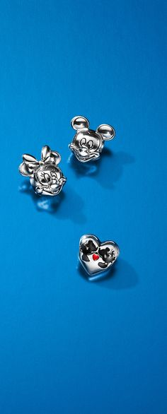 A charming tribute to the iconic Mickey and Minnie Mouse, these sterling silver PANDORA charms are guaranteed to make hearts melt.