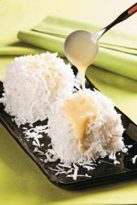 Cuscuz de Tapioca. Tapioca pudding cooked in coconut milk with sugar w/ a splash of sweetened condensed milk over it. YUM!