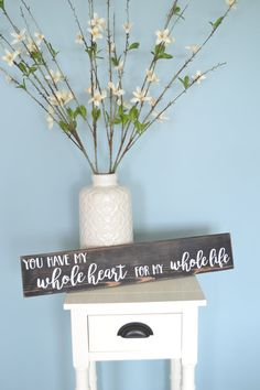 Rustic wooden sign reading, You have my whole heart for my whole life. This would make a sweet touch for a master bedroom or even great decor for your backyard wedding! Also makes a great wedding gift!  Materials: - pine board - sawtooth hooks (on back) - flat black paint (background) - white chalk paint (words)  Measurements: - 4-1/2 (height) x 24 (width) x 3/4 (diameter) - approximately 1/2 lb  ***  PLEASE NOTE:  - This sign is crafted just as the one photographed but the individual…