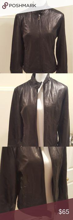 Calvin Klein Genuine Black Leather Women's jacket Beautiful, soft genuine black leather Moto style size m. Cut to perfection. NEVER WORN Calvin Klein Jackets & Coats