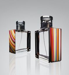 These bottles are so simple yet very powerful. Since Paul Smith is a well known brand the patterns are the only thing that gives away weather the perfume is for men or women. (the straight lines being for men and the curved for women). These perfumes also have the same style throughout their packaging.
