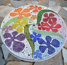 http://www.swanmosaic.com. Mosaic patio table top. Colourful
