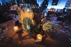Centerpieces had wheat, decorative feathers, and votive candles in mercury glass. Hall's provided the rentals, and BBJ provided linens.  Photo: Nick Jamison for Event Creative