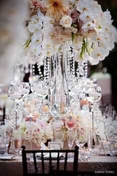 tall and low centerpeices, glass vases, candles and dangling crystals.