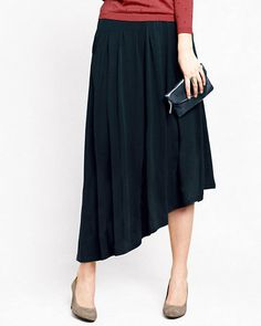 A dramatically asymmetrical hem gives this long skirt great swagger — we think it looks especially cool with boots. Pleats kick out to a draped A-line for a full but not billowy silhouette.
