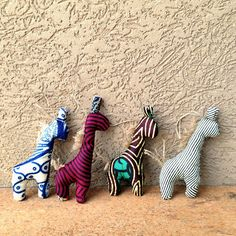 These patterns look familiar? In the late spirit of Christmas, I've created these elephant and giraffe stuffed animal ornaments to spice . African Art Projects, African Crafts, Giraffe Stuffed Animal, African Christmas, Giraffe Illustration, International Craft, Fabric Christmas Ornaments, Childrens Gifts, African Fabric