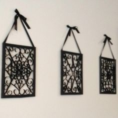 Toilet paper wall art. Dollar frames + toilet paper rolls = faux wrought iron wall art