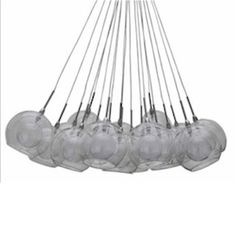 This Means War (2012): This is the same pendant lamps chandelier, model 'Aura' by Nuevo Living, which hangs over the dinner table in FDR Fosters (Chris Pine) stylish & elegant apartment - a strong contrast to Tuck's (Tom Hardy) honest and raw styled loft & character. Click for ORIGINAL scene pics.
