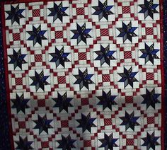 "8 pointed stars are different navy fabrics and red and white blocks are courthouse steps. It is a 80x80"" window covering."""
