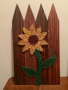Sunflower String Art on stain picket fence