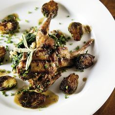 Grilled Quail with Glazed Brussel Sprouts, Pearl Barley, & Sausage | Charleston Magazine