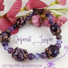 #cpromo Bangle Bracelet Handmade Purple Jasper Amethyst Swarovski Copper Clasp. Royal Imperial Jasper is by far one of my favorite gemstones, with its rich running grains of different colors and deep rich purple. When I thought out this design, it struck me how the copper metal enhanced the Imperial Jasper and just started to build from there. Using the Copper bead caps added a beauty to the design.