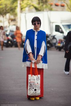 Stefania. blue poncho. floor length red skirt. the bag. yellow shoes poking out. well played girlfriend. Paris.