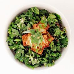 Ingredients * 1T white sesame seeds * 1 bunch kale, deveined and thinly sliced * 1T olive oil * 1T apple cider vinegar (or rice vinegar) * 1T soy sauce * 2t toasted sesame oil * 1 clove garlic, smashed * Generous pinch of salt Toppings * Crushed red pepper flakes * 2 scallions, thinly sliced * ¼ cup cilantro, chopped * Hemp hearts Method 1. In a small bowl, whisk together vinegar, soy sauce, sesame oil, and olive oil. Place the crushed garlic clove in the dressing, and let infuse while ...