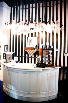 Beauty Salon recption,stripe wallpaper, lighting as a focal point