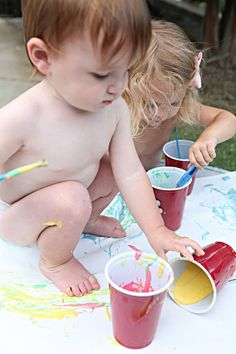 Paint for babies- flour, water, food coloring . Safe if eaten! Look at these little guys going to town, they are loving it!