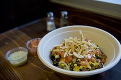 An Ocho bowl brimming with certified Angus steak, fresh pico de gallo, mozzarella cheese, fire roasted corn and grilled squash topped with wheat crisps.