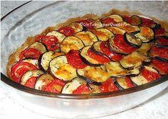 Un Tavolo per Quattro: Melanzane al forno con pomodori e mozzarella