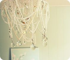 DIY chandelier with vintage necklaces and clear beads.
