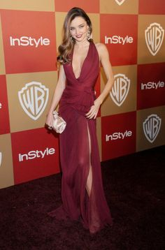 Happy Birthday, Miranda Kerr! See Her Best Red Carpet Moments: At the InStyle and Warner Bros. Golden Globes party, Miranda Kerr married bombshell curves with timeless elegance in a plunging Zuhair Murad gown and Ferragamo accessories — plus strappy sandals and a satin clutch.
