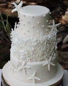 A beautiful starfish wedding cake for a beach wedding.