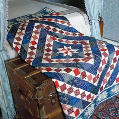 Concentric lines of blue surround the center star block in this scrappy, patriotic throw quilt. Lap Quilts, Scrappy Quilts, Mccall's Quilting, Denim Quilts, Quilting Ideas, Quilt Blocks, Lap Quilt Patterns, Quilt Display, Patriotic Quilts