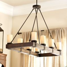"Arturo 8 Light Chandelier | Ballard Designs $400 Dimensions: Overall: 29 1/2""H X 39""W X 18""D Wood Frame: 2 3/8""H Glass Sleeves: 5 1/8""H Each Includes three (3) 12"" & two (2) 6"" extension rods. Construction: Made of wood and metal. Lighting: Uses type A 60W medium base bulbs. Cord 10'L & black. Country of Origin: China Additional Information: Some assembly required."
