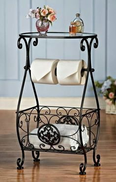 Bathroom Decor Glasstop Bathroom Storage Table Elegant bathroom table has a… Tissue Paper Roll, Wrought Iron Decor, Wrought Iron Designs, Iron Furniture, Bathroom Toilets, Bathrooms, Table Storage, Bathroom Storage, Bathroom Table