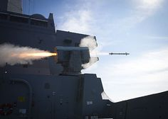 The amphibious transport dock ship USS New Orleans (LPD 18) fires a RIM-116 Rolling Airframe Missile (RAM) from it's forward launcher while off the coast of Southern California during a live fire exercise.