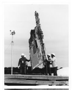 A section of the space shuttle Challenger, destroyed 73 seconds after launch on Jan. is lowered into an abandoned missile silo on the Cape Canaveral Air Force Station in The silos serve as permanent storage facilities for the Challenger debris. Space Shuttle Disasters, Challenger Explosion, Space Shuttle Challenger, Challenger Space, Cape Canaveral, Space Center, Space Program, Our Solar System, Space Shuttle