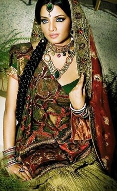 Beautiful photo. aside for the photo being good and subject of it is a really beautiful woman...  I LOVE the outfit! the colors, design, the fabrics, each part of the outfit,,,and the beautiful Jewelry!  - earth tones in a vibrant way.  The Greens are very complementary on her and on brunets and the brown eyed it is even more of an effect...
