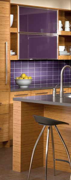 Contemporary Kitchen Design with Bamboo Cabinets uses purple as the backsplash! - Dura Supreme Cabinetry