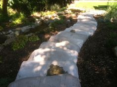 Cambridge Cast Stone Palisades Steps can be stepped back, rotated and positioned in dozens of ways.   These steps were installed by Milazzo Landscape Development.