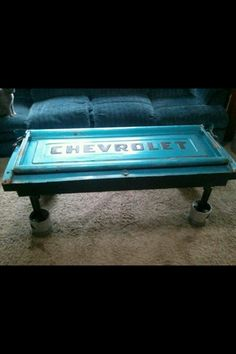 Tail gate from old truck repurposed into a cool coffee table