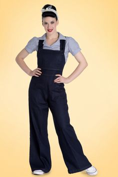 This 40s Emmeline Dungaree is super sassy!  Although this beauty is inspired by the trousers worn by the 1940s Landgirls, it doesn't mean you can't wear her in a sassy way! Due to her flattering wide legs and playful cross-over strap detail to the back she guarantees lots of fun, WITH or WITHOUT a top underneath. Made from a lovely supple, dark blue denim with a light stretch and finished off with typical dark yellow stitching. Heels or sneakers, blouse or shirt, Emmeline is a real…