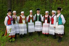 Kurpie Region (Green Forest) Poland - Showing traditional maiden and married wear.