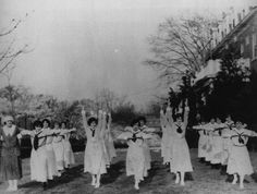 Graduating nurses are taking exercises in front of the nurses' quarters ~1918 (army.mil)