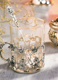 """Russian Tea Glass Holders called podstakannik (Russian: подстака́нник, literally """"thing under the glass""""), or tea glass holder. Their primary purpose is to be able to hold a very hot glass of tea, which is usually consumed right after it is brewed. Hildesheimer Rose, Russian Tea, Russian Style, Teapots And Cups, My Cup Of Tea, Cup And Saucer, Tea Time, Coffee Cups, Coffee Beans"""