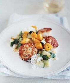 Scallops With Sweet Cucumber and Mango Salsa: Serve seared scallops with a refreshing side of chopped cucumber, mango, ginger, and lime juice.