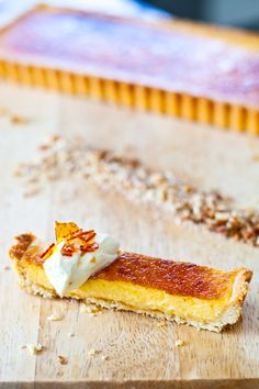 Thomas Keller's lemon sabayon tart with pine nut crust, from eatshowandtell.com
