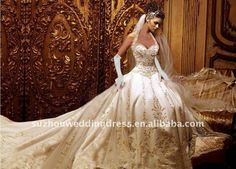A-line embroidered ivory wedding dress with long train.