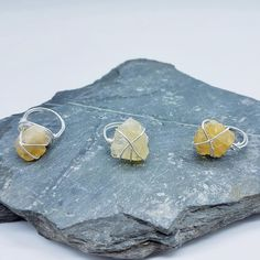 Wire wrapped citrine rough gems using eco-friendly silver 💍⠀ ⠀ Wondering how to make a wire-wrapped ring? We have a brilliant tutorial… Wire Wrapped Rings, Rocks And Gems, Wire Wrapping, Eco Friendly, Stud Earrings, Jewellery, How To Make, Silver, Wire Rings