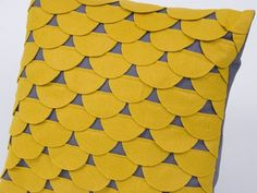 Yellow and grey scalloped pillow