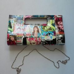 "Magazine print clutch Magnetic snap closure with magazine print. 2 open pockets and one zipper inside. Comes with detachable chain. Approximately 7""L x 12.5""W Bags Clutches & Wristlets"