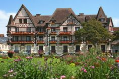 Between Caen and Deauville, Cabourg is a very pretty and well equipped Norman tourist town. In the spring, flower lovers will be seized by its beauty. Wonderful Places, Beautiful Places, Normandie France, Ville France, Need A Vacation, French Countryside, Normandy, Cottage Homes, France Travel