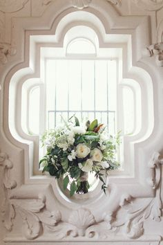 This bright window flanked by white decor and a beautiful bouquet of flowers is just gorgeous. Check out that window shape! #window #shape #white