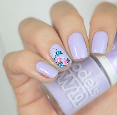 Lavender nail polish with floral accent nail art