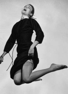 Close-up of Grace Kelly jumping for photographer Philippe Halsman.