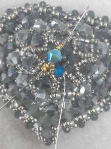 Edgars work has a rich opulence to it that I first noticed back in 2011 while preparing Marcia DeCoster Presents. I asked him to be includ. Heart Jewelry, Beaded Jewelry, Beaded Necklace, Jewelry Patterns, Beading Patterns, Beaded Cross, Necklace Tutorial, Engagement Ring Sizes, Beaded Brooch